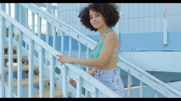 Charming Black Woman on Beach