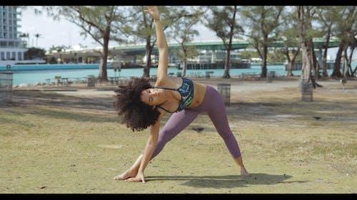 Black Sportive Girl Training Asana on Lawn