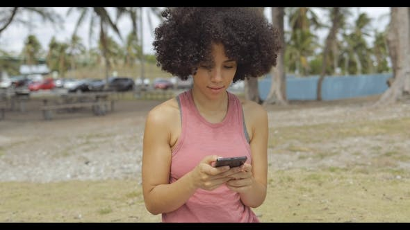 Thumbnail for Pretty Girl Using Phone in Park