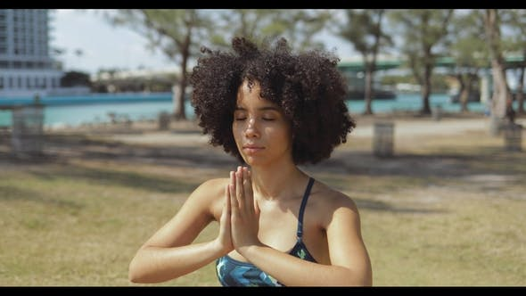 Thumbnail for Content Black Woman Meditating with Eyes Closed