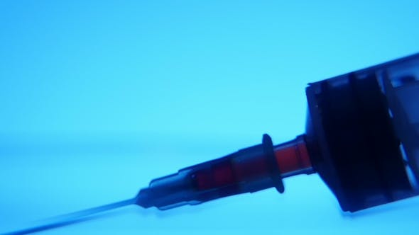 Thumbnail for Red Liquid Is Taken Into a Syringe with a Needle in a Medial Laboratory