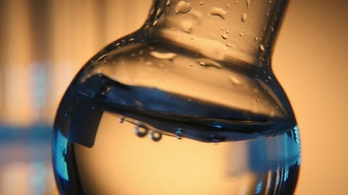 Distilled Water Is Shaken in a Round Bottom Flask in a Medical Laboratory