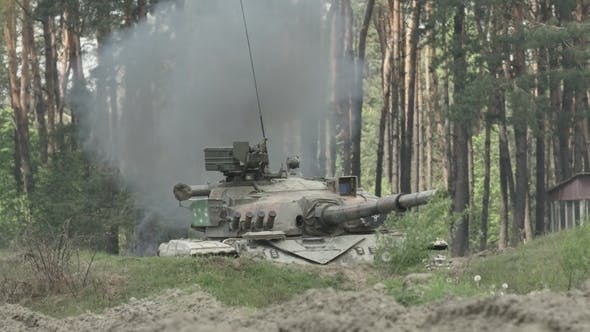 Military Tank Shoots On The Target