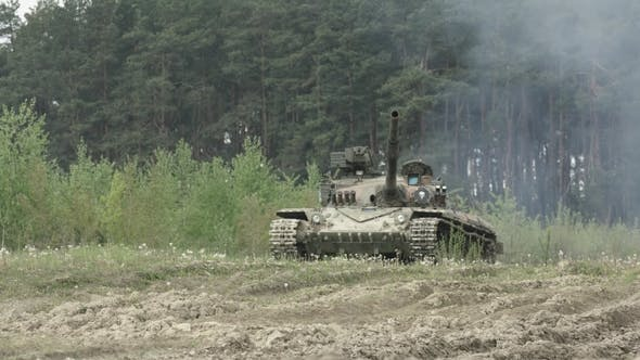 Cover Image for Military Tank In Movement On A Dirt Ground Terrain