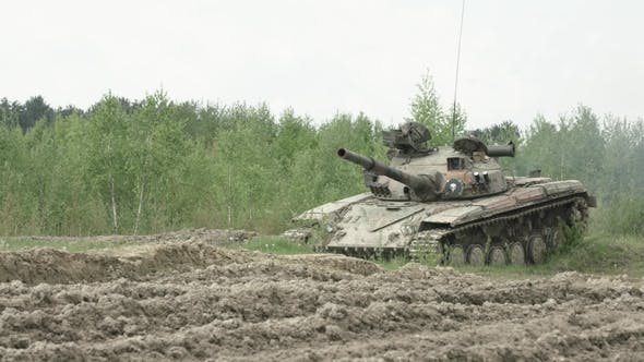 Thumbnail for Military Tank in Movement on a Dirt Ground Terrain