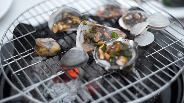 Thumbnail for Mussels Are Roasted in the Sauce on the Open Fire of Grill, Cooking of Shellfish Outdoors, Seafood