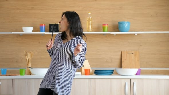 Thumbnail for Happy Woman Dancing and Singing in the Kitchen