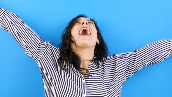 Thumbnail for Excited and Happy Woman on Blue Background