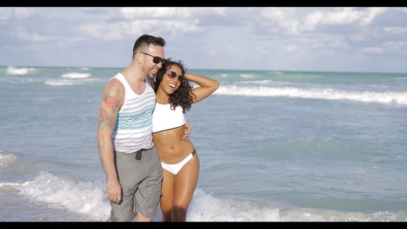Thumbnail for Multiethnic Cheerful Couple on Seaside