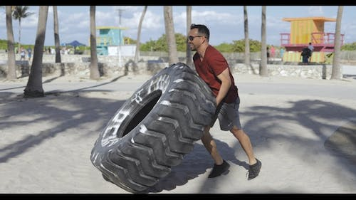 Man Working Out with Tyre