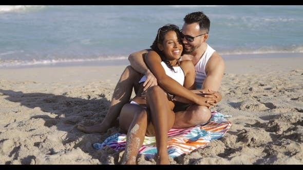 Thumbnail for Cuddling Happy Couple on Beach