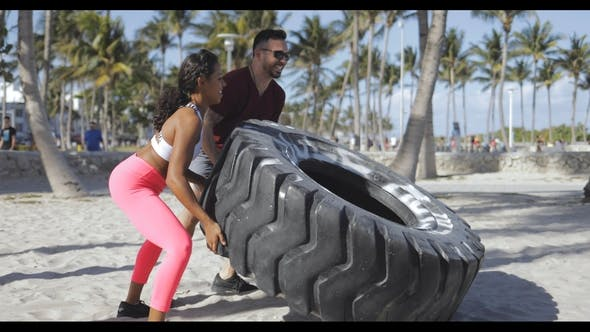 Thumbnail for Sportive Couple Training with Tyre Together