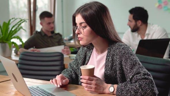 Thumbnail for Girl Works in Office