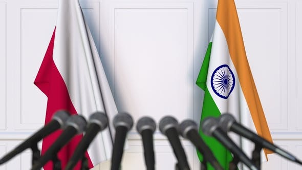 Cover Image for Flags of Poland and India at International Press Conference
