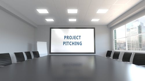 PROJECT PITCHING Caption on the Screen in a Meeting Room