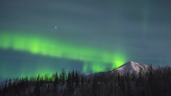 Thumbnail for Green Northern Lights. Snowy Mountain and Trees at Winter Night