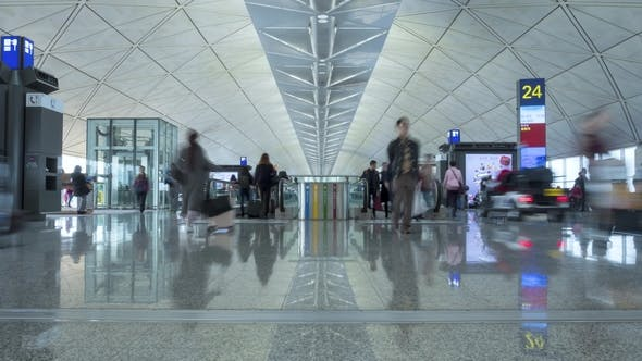Thumbnail for People Are Walking and Using Travelators at Airport