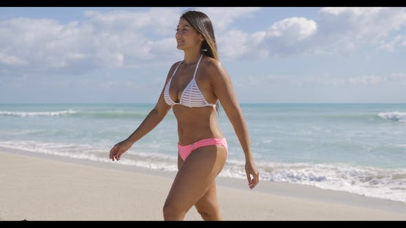 Thumbnail for Smiling Attractive Woman Walking on Coast