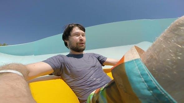 Thumbnail for Young Man Sliding Down at the Aquapark