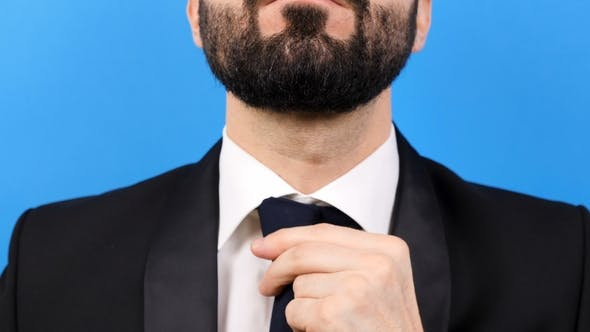Thumbnail for Businessman Carefully Arranges His Tie