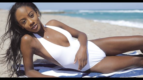 Thumbnail for Seductive Ethnic Woman Lying on Beach