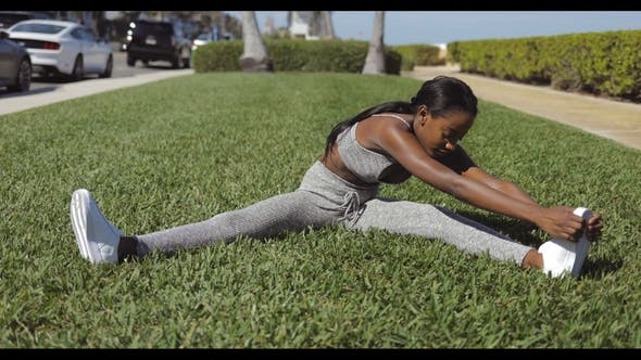 Thumbnail for Black Woman Stretching in Sunny Park