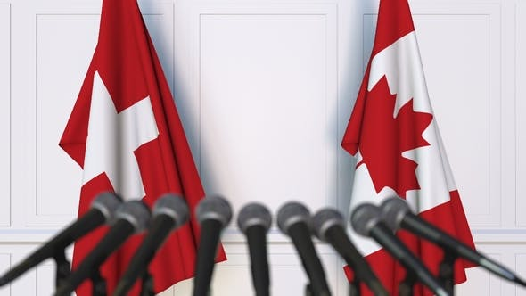 Thumbnail for Flags of Switzerland and Canada at International Press Conference