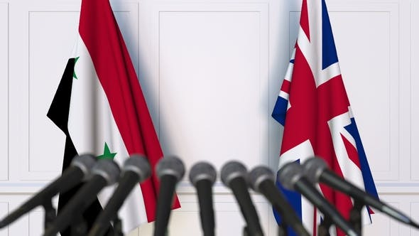 Thumbnail for Flags of Syria and The United Kingdom at International Press Conference