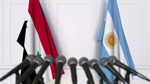 Thumbnail for Flags of Syria and Argentina at International Press Conference
