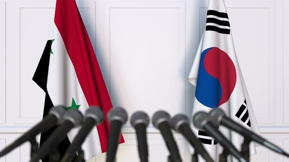 Thumbnail for Flags of Syria and Korea at International Press Conference