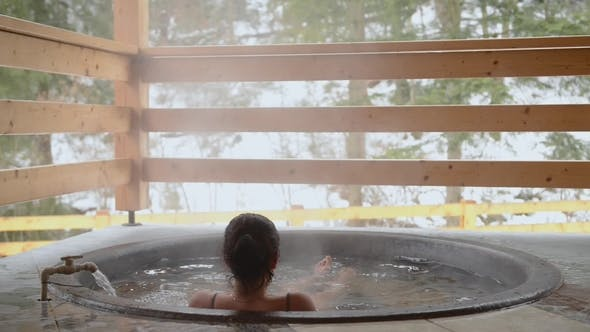 Thumbnail for A Girl Is Bathing in the Cast Iron Vat with Mineral Water