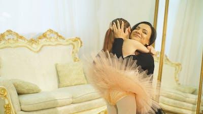Mom Ballerina Hugs Her Daughter Ballerina