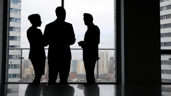 Thumbnail for Business Team of Managers Standing Talk in Office