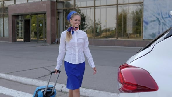 Thumbnail for Flight Attendant in Blue Uniform Keeps Travel Bag near Car on Background Airport