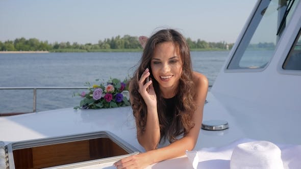 Thumbnail for Phone Conversation of Young Woman on Deck Yacht on Summer Rest