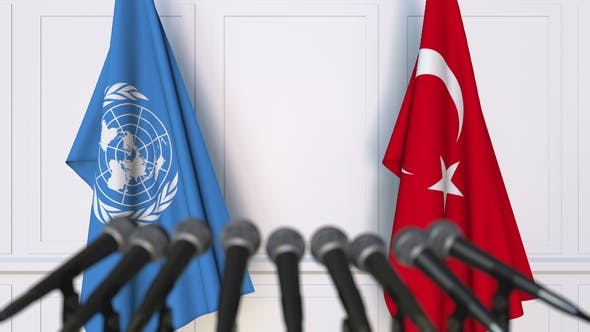 Thumbnail for Flags of the United Nations and Turkey at International Press Conference