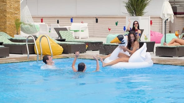 Thumbnail for Company of People Swimming in the Pool Happy Group of People Make Splashes of Water