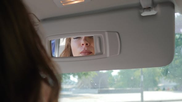 Thumbnail for Feminine Lips and Eyes Reflected in Automobile Mirror
