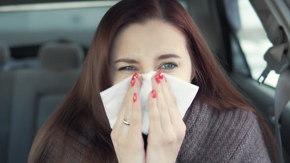 Thumbnail for a Woman Blows Her Nose in the Car