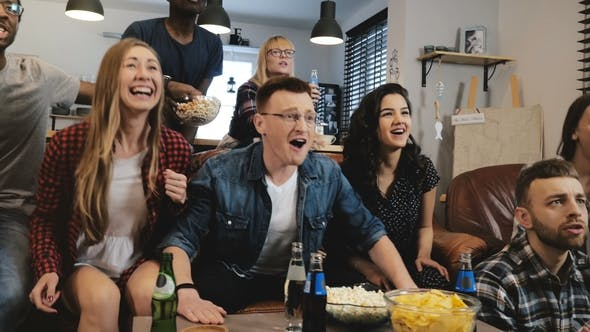 Thumbnail for Diverse Football Fans Get Wild Celebrating Win  . Happy Multi Ethnic Friends Watching Sports on T