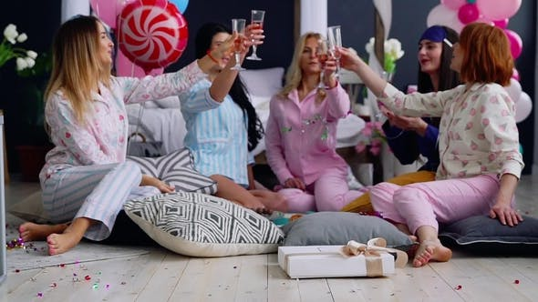 Thumbnail for Group of Dancing Girls at a Pajama Party with Glasses of Champagne Laugh and Smile
