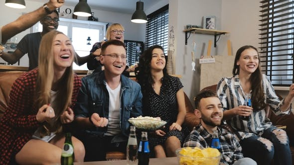 Thumbnail for Mixed Ethnicity Friends Watching Funny Film on TV. Medium Shot. Passionate and Cheerful Football