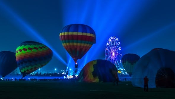 Thumbnail for Hot Air Balloons Light Up the Night on the Field with People Walking Around Balloon Festival. Astana