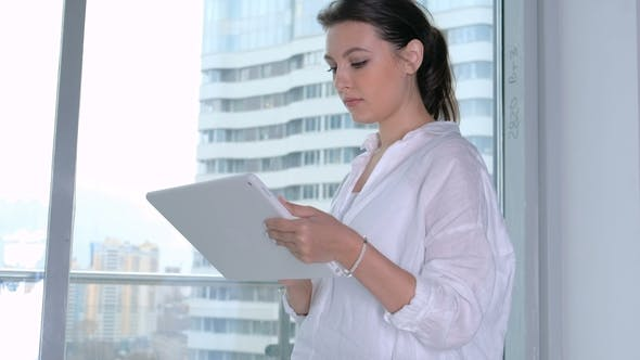 Thumbnail for Young Businesswoman Using Tablet in Office