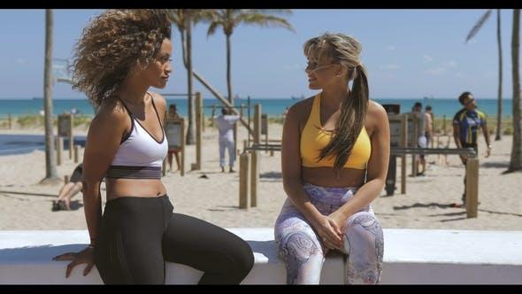 Thumbnail for Content Multiethnic Women in Sportswear on Shore