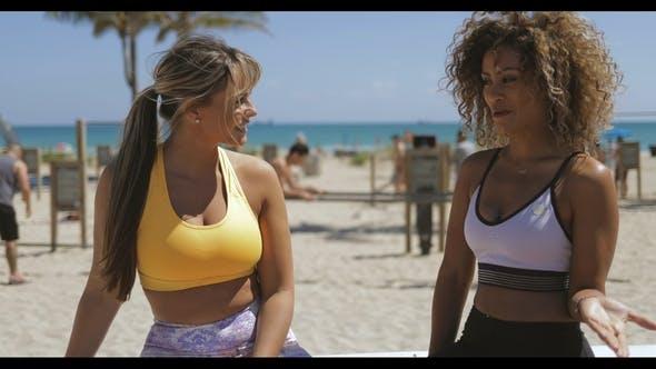 Thumbnail for Chatting Sportswomen on Tropical Shore
