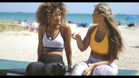 Thumbnail for Relaxing Sportive Women Chilling on Beach