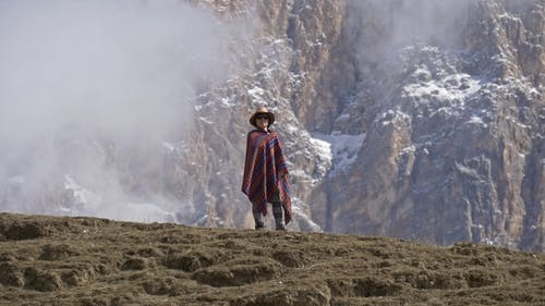 Original American Woman Standing in a Poncho