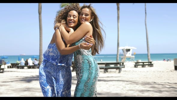 Thumbnail for Embracing Happy Women on Beach