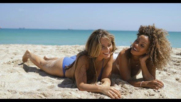 Thumbnail for Cheerful Girls Sunbathing on Shore